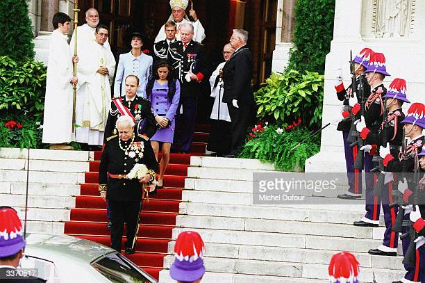 Prince Rainier III of Monaco outside the cathedral after mass with his children Princess Caroline and Prince Albert celebrating principality's...