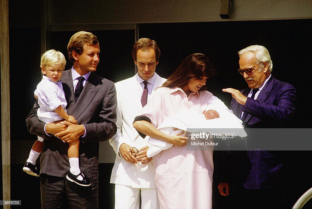 Prince Rainier III of Monaco poses for the birth of Princess Caroline's baby Charlotte Casiraghi as Stefano Casiraghi with son Andrea and Prince Albert also stand outside the Princess Grace Hospital in 1986 in Monte Carlo, Monaco.