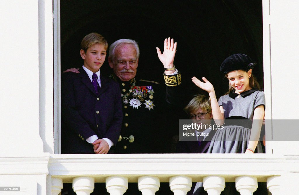 Prince Rainier III of Monaco waves from the balcony of the palace with Prince Albert and Prince Andrea celebrating principality's National Day on November 19, 1996 in Monte Carlo, Monaco.