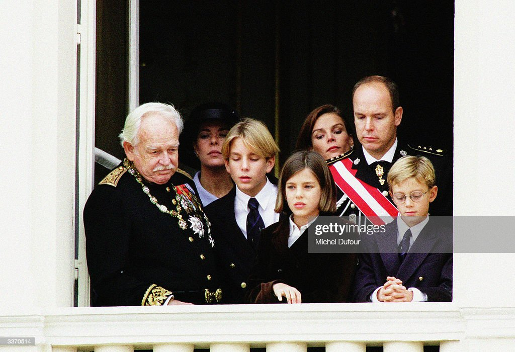 Prince Rainier III of Monaco waves from the balcony of the palace with Prince Andrea, Princess Charlotte, and Prince Pierre, with Princess Caroline, Princess Stephanie,and Prince Albert celebrating principality's National Day on November 19, 1997 in Monte Carlo, Monaco.