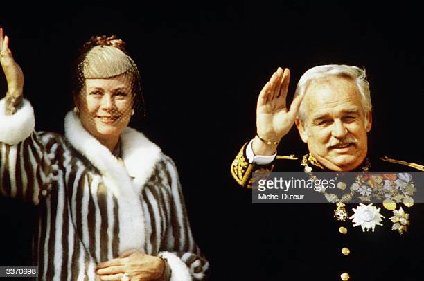Prince Rainier III of Monaco waves from the balcony of the palace with wife Princess Grace Kelly celebrating principality's National Day on November...