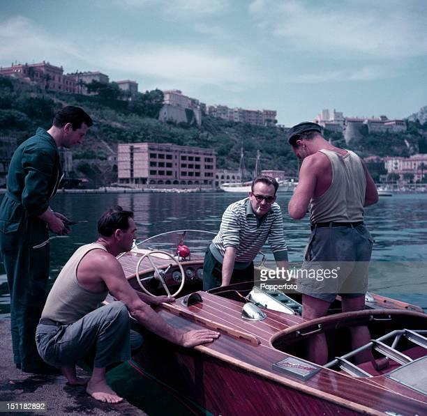 Prince Rainier III of Monaco with his speedboat mechanics on the Bay of Monaco circa 1954