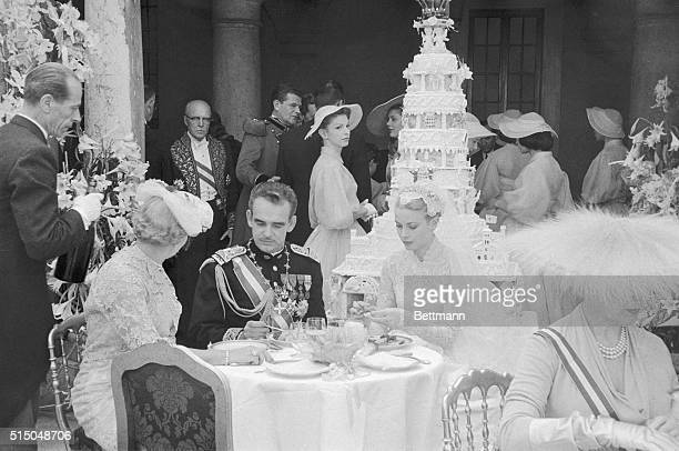 Prince Rainier III ruler of Monaco and his lovely American princessbride Grace Patricia Kelly are shown in the palace during the reception which...