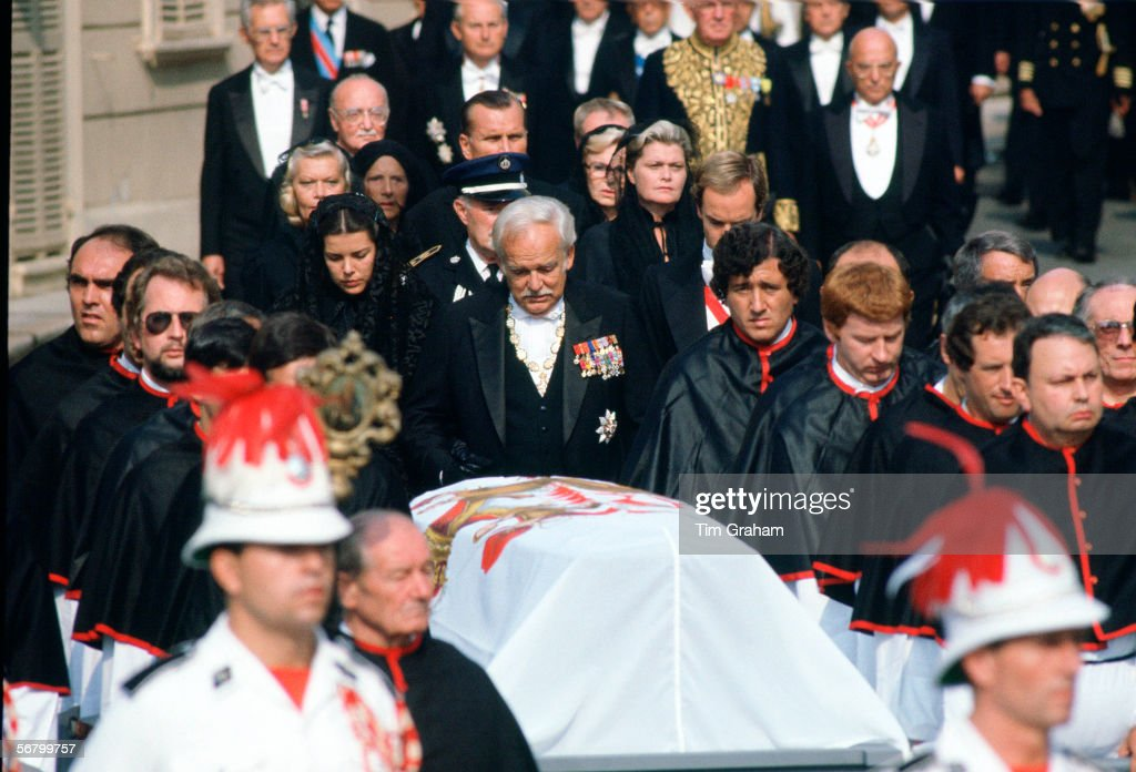 Prince Rainier, with his daughter Princess Caroline and his son Prince Albert, walks behind the coffin of his wife at the funeral of Princess Grace of Monaco.