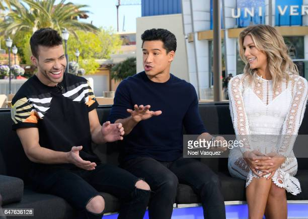 Prince Royce Mario Lopez and Charissa Thompson visit 'Extra' at Universal Studios Hollywood on March 3 2017 in Universal City California