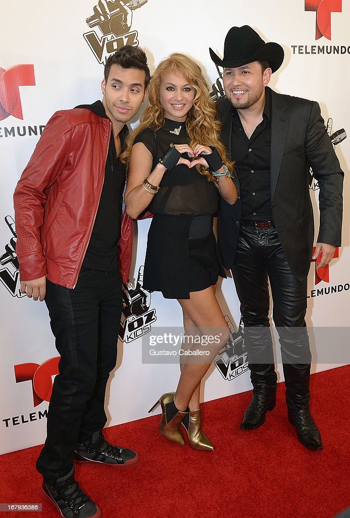 <a gi-track='captionPersonalityLinkClicked' href=/galleries/search?phrase=Prince+Royce&family=editorial&specificpeople=6918529 ng-click='$event.stopPropagation()'>Prince Royce</a>, <a gi-track='captionPersonalityLinkClicked' href=/galleries/search?phrase=Paulina+Rubio&family=editorial&specificpeople=201804 ng-click='$event.stopPropagation()'>Paulina Rubio</a> and Roberto Tapia attends a press conference for Telemundo's 'La Voz Kids' on May 2, 2013 in Miami, Florida.