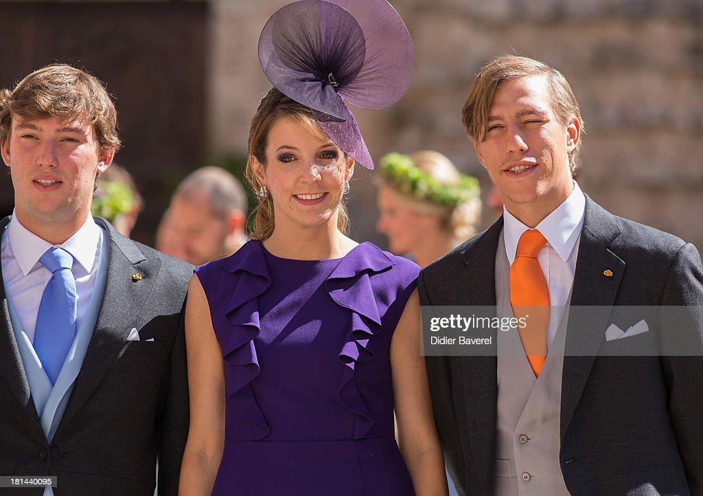 Prince Sebastien Of Luxembourg, Princess Tessy Of Luxembourg and Prince Louis Of Luxembourg leave the religious wedding of Prince Felix of Luxembourg and Claire Lademacher at Basilique Sainte Marie-Madeleine on September 21, 2013 in Saint-Maximin-La-Sainte-Baume, France.