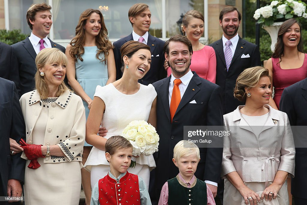 Prince Sebastien, Princess Tessy, Prince Louis, Crown Princess Stephanie, Crown Prince Guillaume, Princess Alexandra, (middle row) Hartmut Lademacher, Gabriele Lademacher-Schneider, <a gi-track='captionPersonalityLinkClicked' href=/galleries/search?phrase=Princess+Claire+of+Luxembourg&family=editorial&specificpeople=9040476 ng-click='$event.stopPropagation()'>Princess Claire of Luxembourg</a>, Prince Felix Of Luxembourg, Her Royal Highness <a gi-track='captionPersonalityLinkClicked' href=/galleries/search?phrase=Grand+Duchess+Maria+Teresa&family=editorial&specificpeople=159000 ng-click='$event.stopPropagation()'>Grand Duchess Maria Teresa</a> Of Luxembourg, His Royal Highness <a gi-track='captionPersonalityLinkClicked' href=/galleries/search?phrase=Grand+Duke+Henri+Of+Luxembourg&family=editorial&specificpeople=159003 ng-click='$event.stopPropagation()'>Grand Duke Henri Of Luxembourg</a>, (front row) Prince Gabriel and Prince Noah pose in front of photograhers following the Civil Wedding Of Prince Felix Of Luxembourg & Claire Lademacher at Villa Rothschild Kempinski on September 17, 2013 in Konigstein, Germany.
