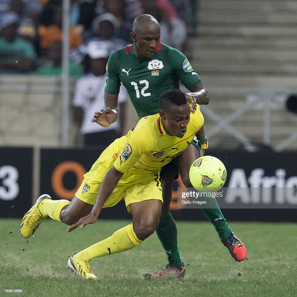Prince Segbefia from Togo tackled by Saidou Mady Panandetiguiri from Burkina Faso during the 2013 Orange African Cup of Nations 4th Quarter Final match between Burkina Faso and Togo at Mbombela Stadium on February 03, 2013 in Nelspruit, South Africa.