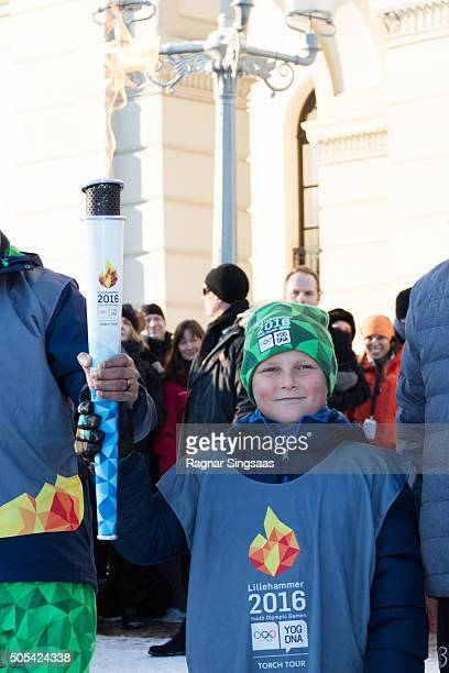 Prince Sverre Magnus of Norway carries the Olympic torch for the 2016 Youth Olympic Games during the 25th anniversary of King Harald V and Queen...