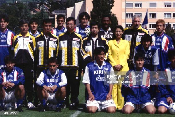 Prince Takamado and his wife Hisako pose for photographs with the national team members during a training session on June 17 1998 in AixlesBains...