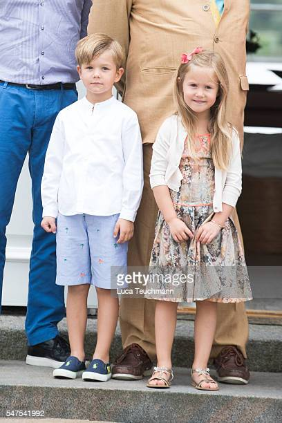 Prince Vincent of Denmark and Princess Josephine of Denmark pose for photographers at the annual summer photo call for The Danish Royal Family at...