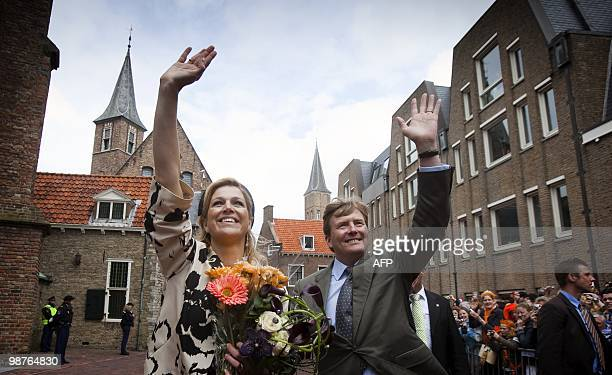 Prince Willem Alexander and Princess Maxima wave to the crowd during the celebration of Queensday in Middelburg Netherlands 0n April 30 2010 AFP...