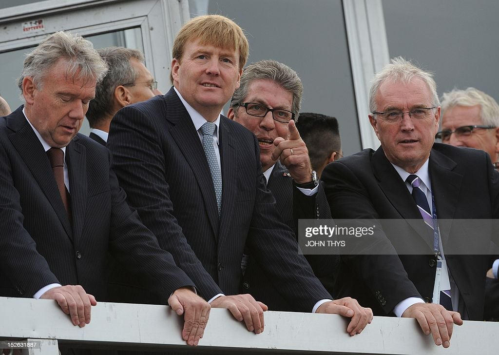 Prince Willem-Alexander of the Netherlands (2nd L) and International Cycling Union (UCI) president Pat McQuaid (R) look on during the UCI Road World Championships on September 23, 2012 in Valkenburg.
