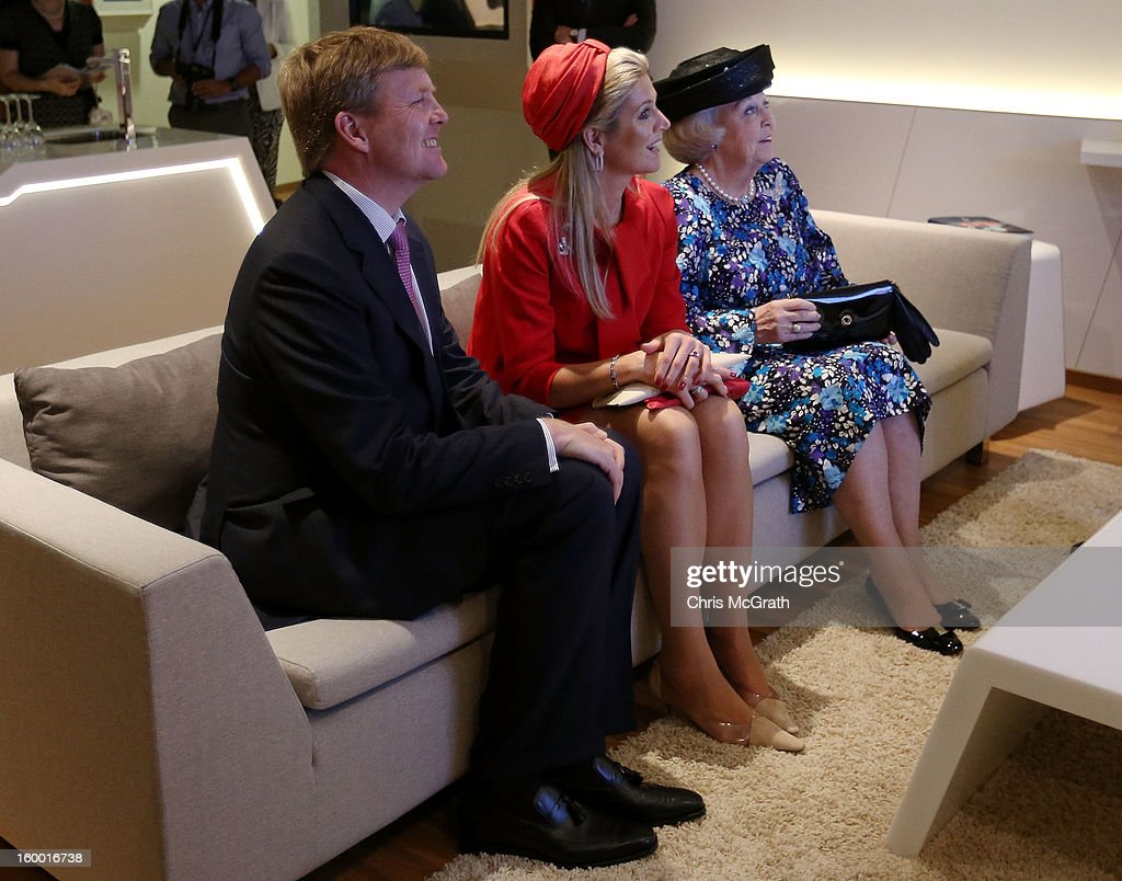 Prince Willem-Alexander, Princess Maxima and Queen Beatrix of the Netherlands watch a demonstration during a tour of the Singapore A*Star Fusionworld on January 25, 2013 in Singapore, Singapore. Queen Beatrix is on a three day state visit to Singapore.