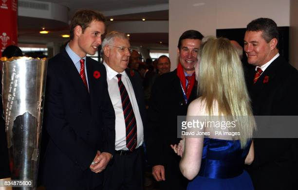 Prince William accompanied by Welsh Rugby Union officers Dennis Gethin Roger Lewis and David Pickering talks to royal harpist Claire Jones before...