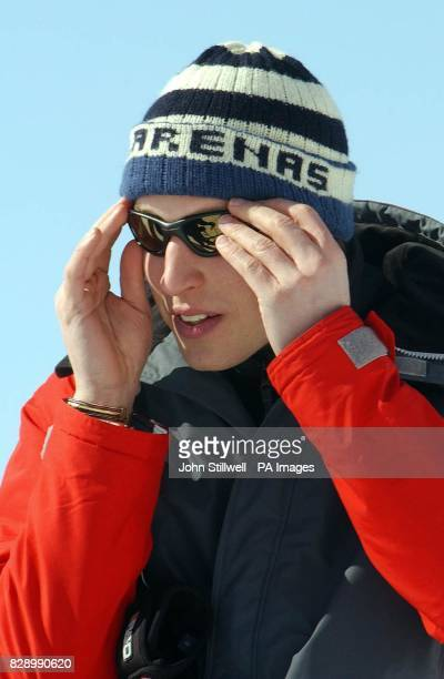 Prince William adjusts his sunglasses before leaving the waiting media on the Madrisa ski slopes above the Swiss village of Klosters The Prince along...