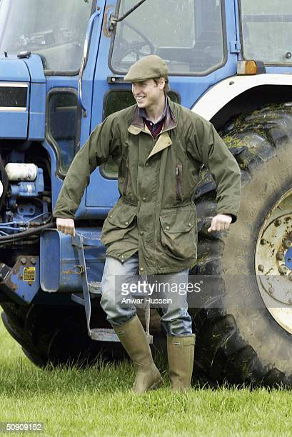 Prince William alights a tractor during a visit to Duchy Home Farm as part of his ongoing interest in farming and his father's estate May 29 2004 in...