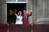 Prince William and Catherine Duchess of Cambridge greet wellwishers from the balcony at Buckingham Palace after their wedding London 29th April 2011