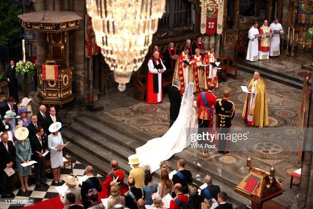 Prince William and Catherine Middleton are seen at the altar during their wedding ceremony at Westminster Abbey on April 29 2011 in London England...