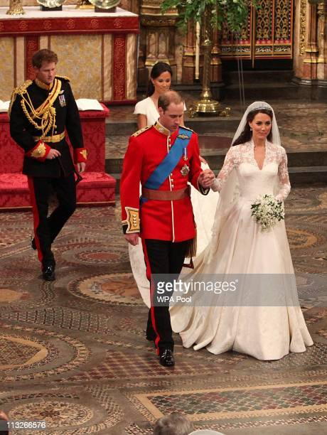 Prince William and his new bride Catherine Middleton leave Westminster Abbey followed by Prince Harry and Pippa Middleton on April 29 2011 in London...