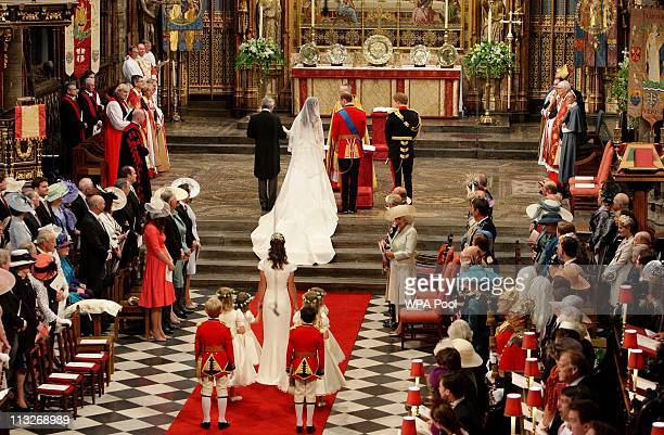 Prince William and his new bride Catherine Middleton stand side by side at the beginning of their wedding ceremony at Westminster Abbey on April 29...