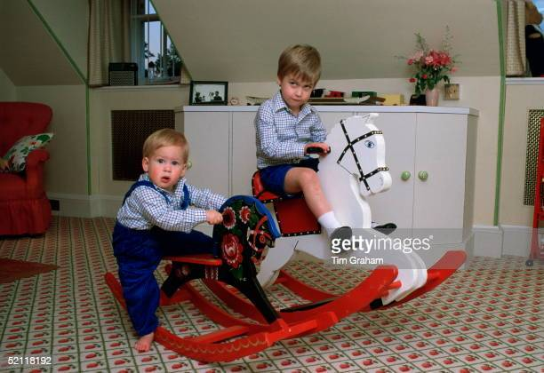 Prince William And Prince Harry Playing On A Rocking Horse In Their Playroom At Kensington Palace