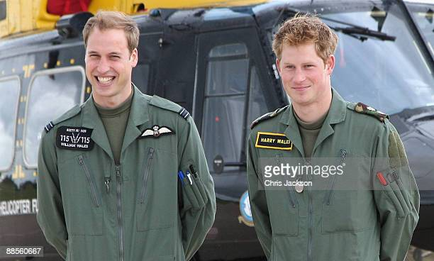 Prince William and Prince Harry pose in front of a Griffin helicopter during a photocall at RAF Shawbury on June 18 2009 in Shawbury England Both the...