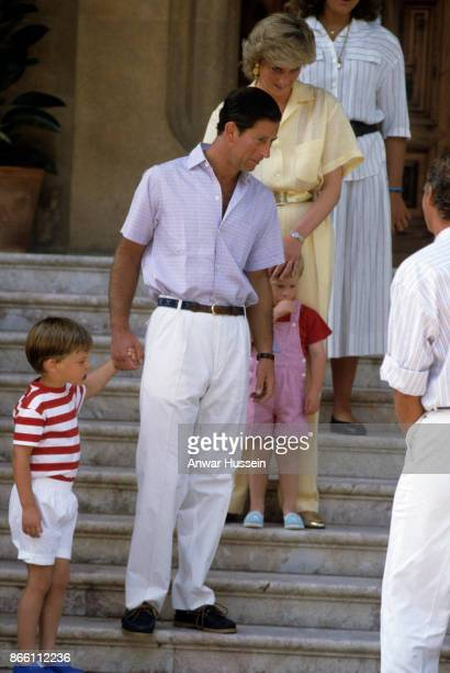 Prince William and Prince Harry pose with Prince Charles Prince of Wales and Princess Diana Princess of Wales during a holiday in Majorca on August...
