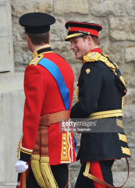 Prince William and Prince Harry share a joke as they arrive to attend the Royal Wedding of Prince William to Catherine Middleton at Westminster Abbey...