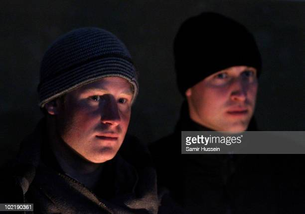 Prince William and Prince Harry stand in candlelight at the Herd Boy Night School on June 17 2010 in Semonkong Lesotho The Princes are on a joint...