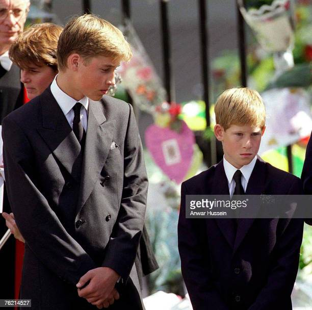Prince William and Prince Harry stand outside Westminster Abbey at the funeral of Diana Princess of Wales on September 6 1997 in London England