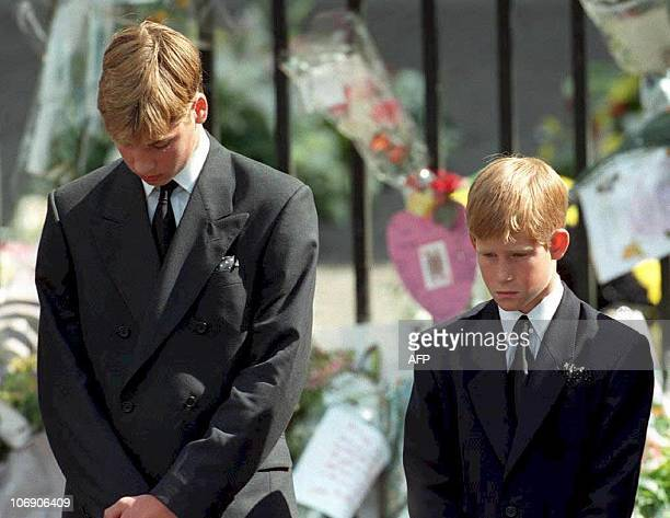 Prince William and Prince Harry the sons of Diana Princess of Wales bow their heads as their mother's coffin is taken out of Westminster Abbey 06...