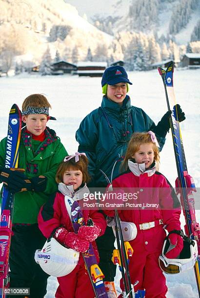Prince William And Prince Harry With Their Cousins Princess Beatrice And Princess Eugenie Posing For A Photocall During Their Skiing Holiday