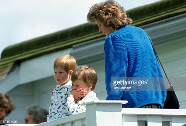 Prince William And Prince Harry With Their Nanny Watching Their Father Play Polo At Guards Polo Club The Princes Are Wearing Identical Patterned...