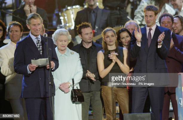Prince WIlliam applauds as the Prince of Wales makes a speech in praise of his mother Britain's Queen Elizabeth II on stage in the gardens of...