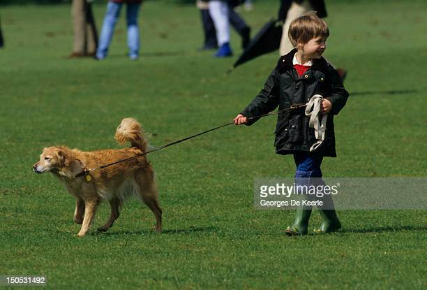 Prince William at polo in Cirencester walking a pet dog