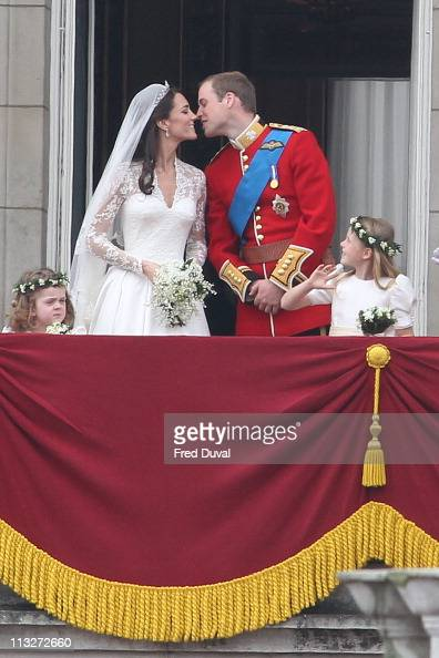 Prince William Catherine and Duchess of Cambridge kiss on the balcony at Buckingham Palace on April 29 2011 in London England The marriage of the...