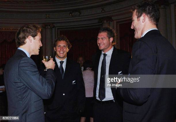 Prince William chats to New Zealand rugby players at a reception hosted for them by the Queen at Buckingham Palace London Monday November 14 2005...