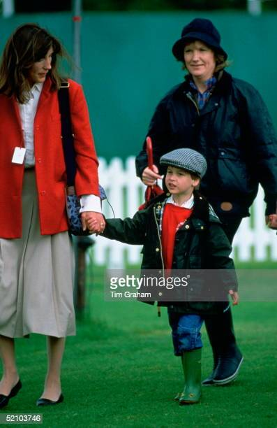 Prince William Dressed In A Barbour Style Waxed Rain Jacket Jeans 'wellipet' Wellington Boots And A Tweed Cap Walking Around The Grounds Of...