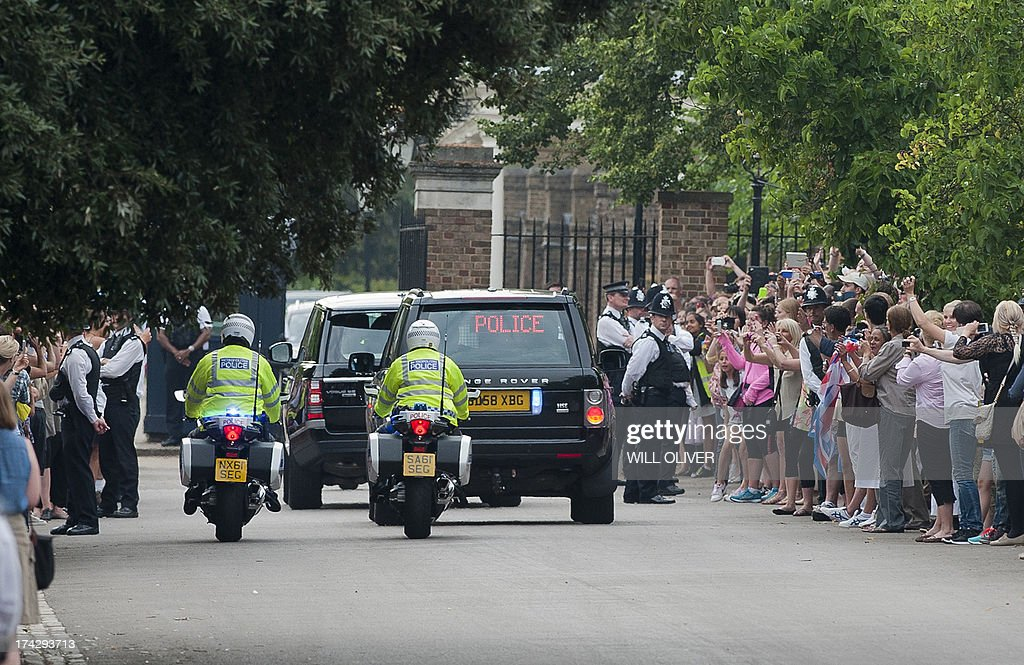 Prince William drives Catherine, Duchess of Cambridge and their new-born baby boy back to Kensington Palace in London on July 23, 2013. The baby was born on Monday afternoon weighing eight pounds six ounces (3.8 kilogrammes). The royal couple have led a relatively simple married life until now at a farmhouse in Wales close to William's airbase, though after the birth they will move into London's Kensington Palace, which has been refurbished at a cost of £1 million of British taxpayers' money. AFP PHOTO / WILL OLIVER