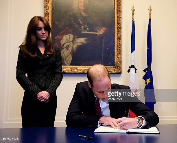 Prince William Duke of Cambridge accompanied by Catherine Duchess of Cambridge signs the book of condolences after the terror attacks which killed at...