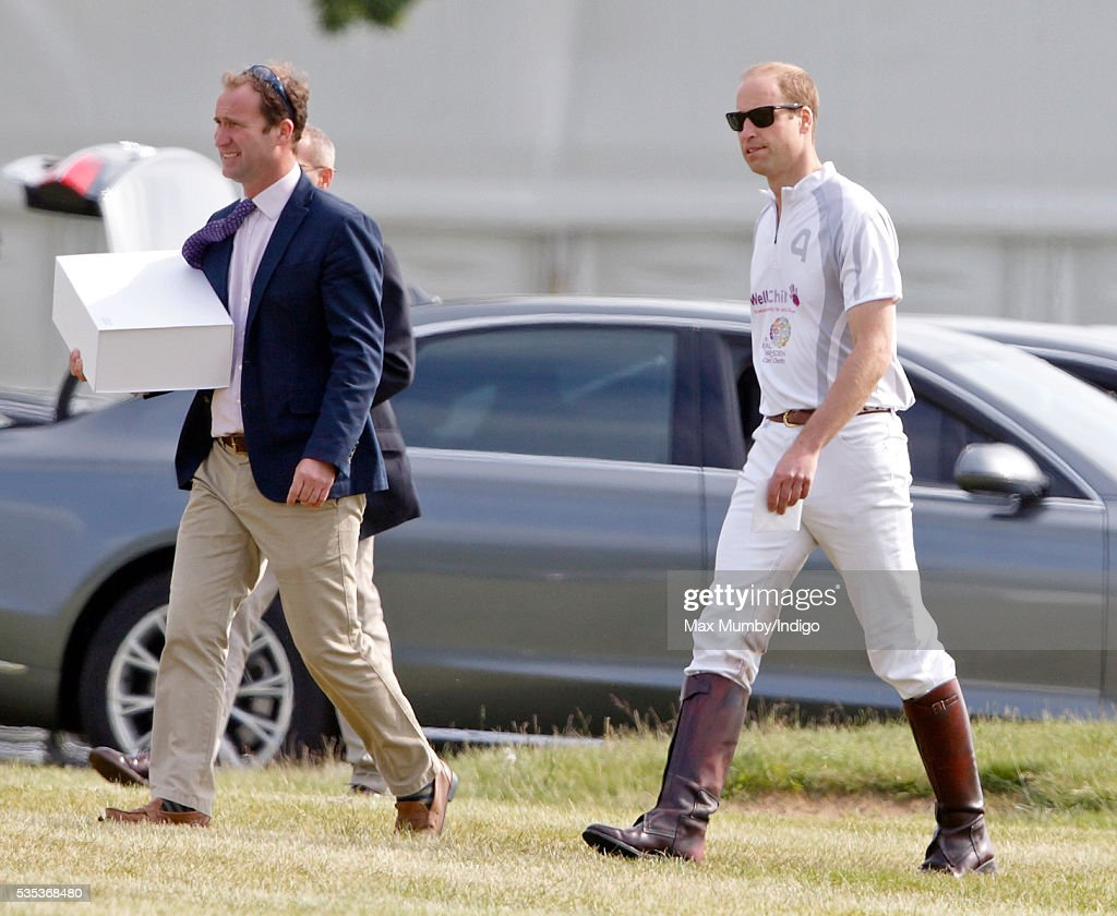 Prince William, Duke of Cambridge accompanied by his polo manager Andrew Tucker attends the Audi Polo Challenge at Coworth Park Polo Club on May 29, 2016 in Ascot, England.