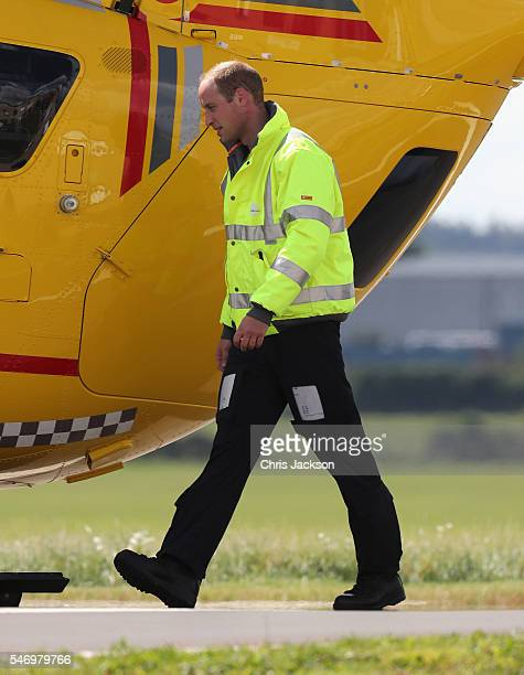 Prince William Duke of Cambridge after piloting his air ambulance at the new East Anglian Air Ambulance Base after a callout at Cambridge Airport on...