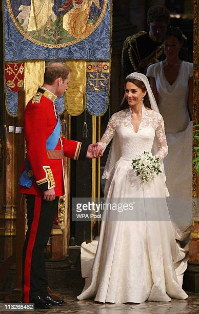 Prince William Duke of Cambridge and Catherine Duchess of Cambridge prepare to leave Westminster Abbey following their marriage ceremony on April 29...
