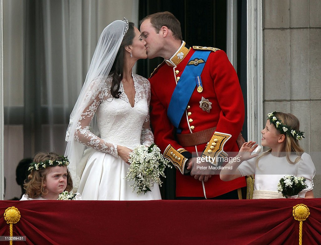 Prince William Duke of Cambridge and Catherine Duchess of Cambridge kiss as Bridesmaids Grace Van Cutsem and Margarita ArmstrongJones look on from...