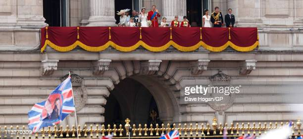 Prince William Duke of Cambridge and Catherine Duchess of Cambridge pose on the balcony of Buckingham Palace during the Royal Wedding of Prince...
