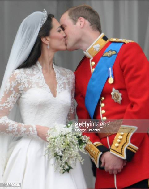 Prince William Duke of Cambridge and Catherine Duchess of Cambridge kiss on the balcony at Buckingham Palace on April 29 2011 in London England