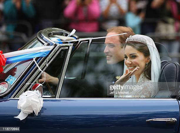 Prince William Duke of Cambridge and Catherine Duchess of Cambridge drive from Buckingham Palace in a decorated sports car on April 29 2011 in London...