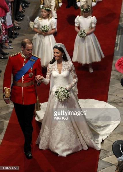 Prince William Duke of Cambridge and Catherine Duchess of Cambridge leave Westminster Abbey following their marriage ceremony on April 29 2011 in...